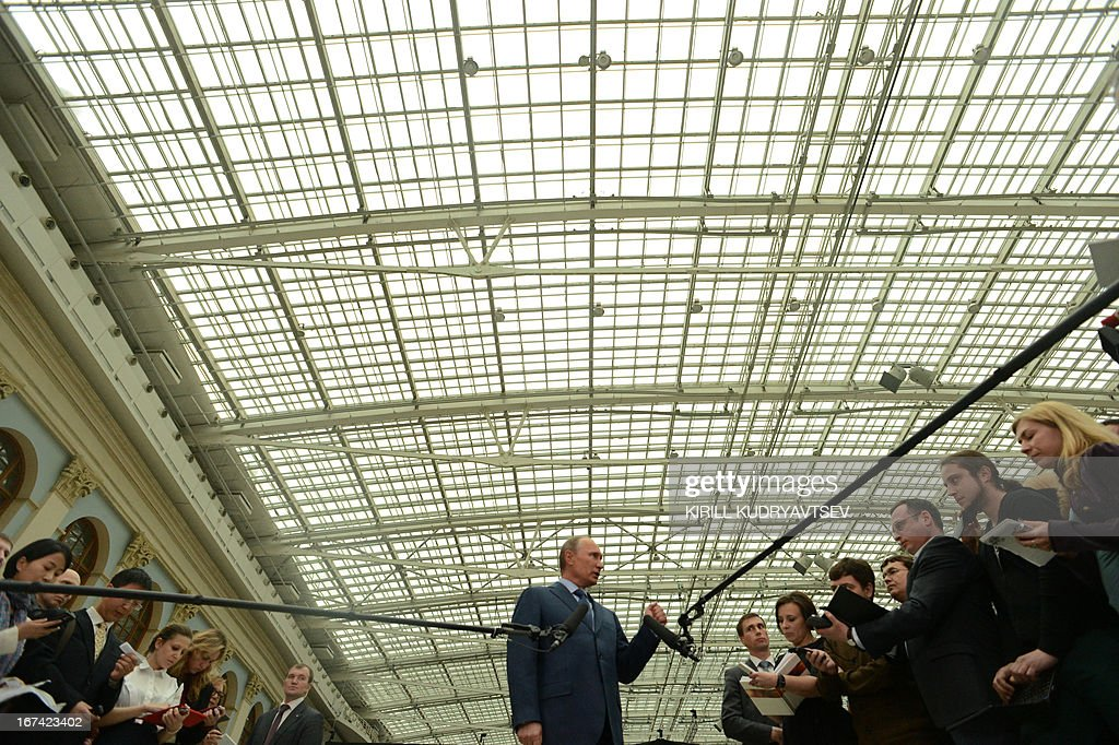 Russia's President Vladimir Putin speaks with journalists shortly after his televised question and answer session with the nation in Moscow, on April 25, 2013. Putin called today for greater anti-terror cooperation with the United States and defended his economic policies against a background of rising discontent, in the first nationwide phone-in of his new Kremlin term.