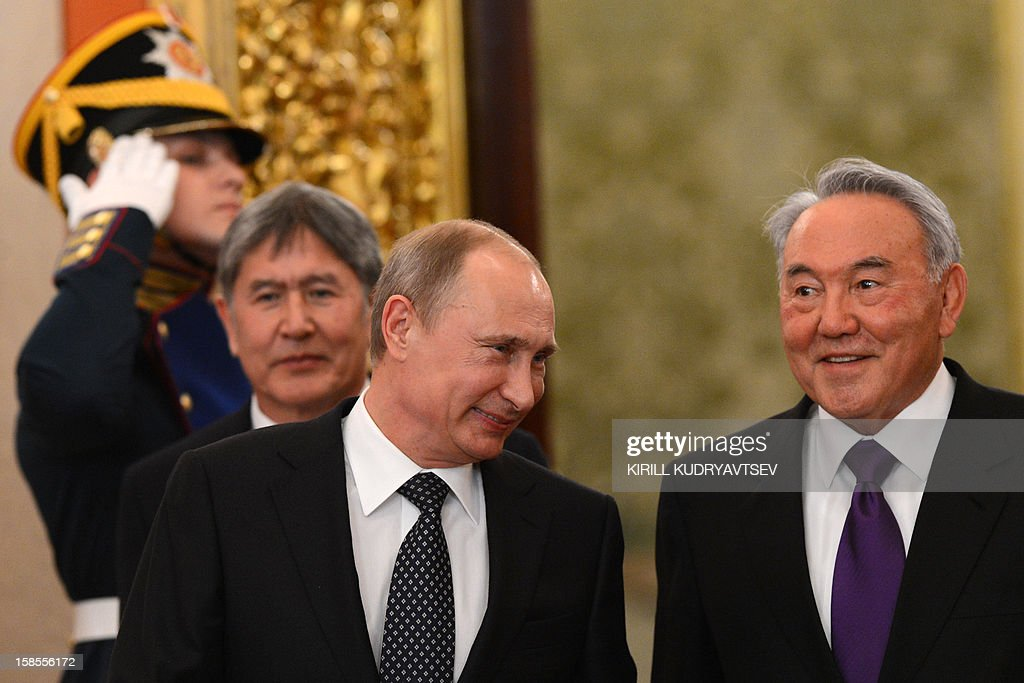 Russia's President Vladimir Putin (C) speaks with Kazakhstan President Nursultan Nazarbayev, during a meeting of the ex-Soviet nations leaders in the Kremlin in Moscow, on December 19, 2012, with Kyrgyzstan's President Almazbek Atambayev (L) attending. Russia sought today to expand its sway over ex-Soviet nations as it hosted economic integration talks Washington has painted as an attempt by Moscow to 're-Sovietise' the region. AFP PHOTO / POOL / KIRILL KUDRYAVTSEV