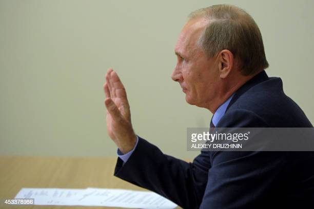 Russia's President Vladimir Putin takes part a video conference with Arctic oil drilling platform West Alpha in the Bocharov Ruchei residence outside...