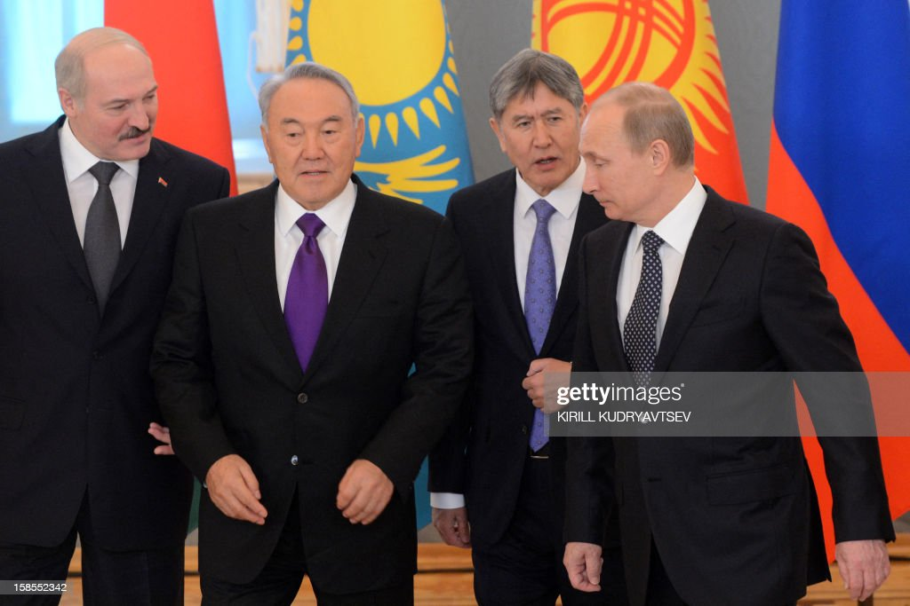 Russia's President Vladimir Putin (R) takes part in a family photo session with the leaders ex-Soviet nations as they meet in the Kremlin in Moscow, on December 19, 2012. Shown (L-R) are: Belarus President Alexander Lukashenko, Kazakh President Nursultan Nazarbayev and Kyrgyz President Almazbek Atambayev. Russia sought today to expand its sway over ex-Soviet nations as it hosted economic integration talks Washington has painted as an attempt by Moscow to 're-Sovietise' the region.