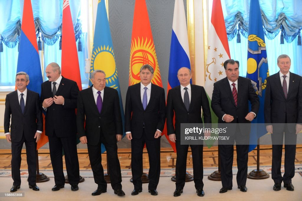 Russia's President Vladimir Putin (3rd R) takes part in a family photo session with the leaders ex-Soviet nations as they meet in the Kremlin in Moscow, on December 19, 2012. Shown (L-R) are: Armenian President Serzh Sarksian, Belarus President Alexander Lukashenko, Kazakh President Nursultan Nazarbayev, Kyrgyz President Almazbek Atambayev, Putin, Tajik President Emomali Rakhmon and Collective Security Treaty Organisation (CSTO) chairman Nikolai Bordyuzha. Russia sought today to expand its sway over ex-Soviet nations as it hosted economic integration talks Washington has painted as an attempt by Moscow to 're-Sovietise' the region. AFP PHOTO / POOL / KIRILL KUDRYAVTSEV