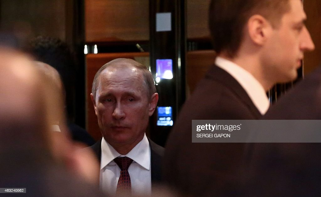 Russia's President Vladimir Putin uses an elevator at the presidential residence in Minsk on February 12 during a meeting aimed at ending 10 months...