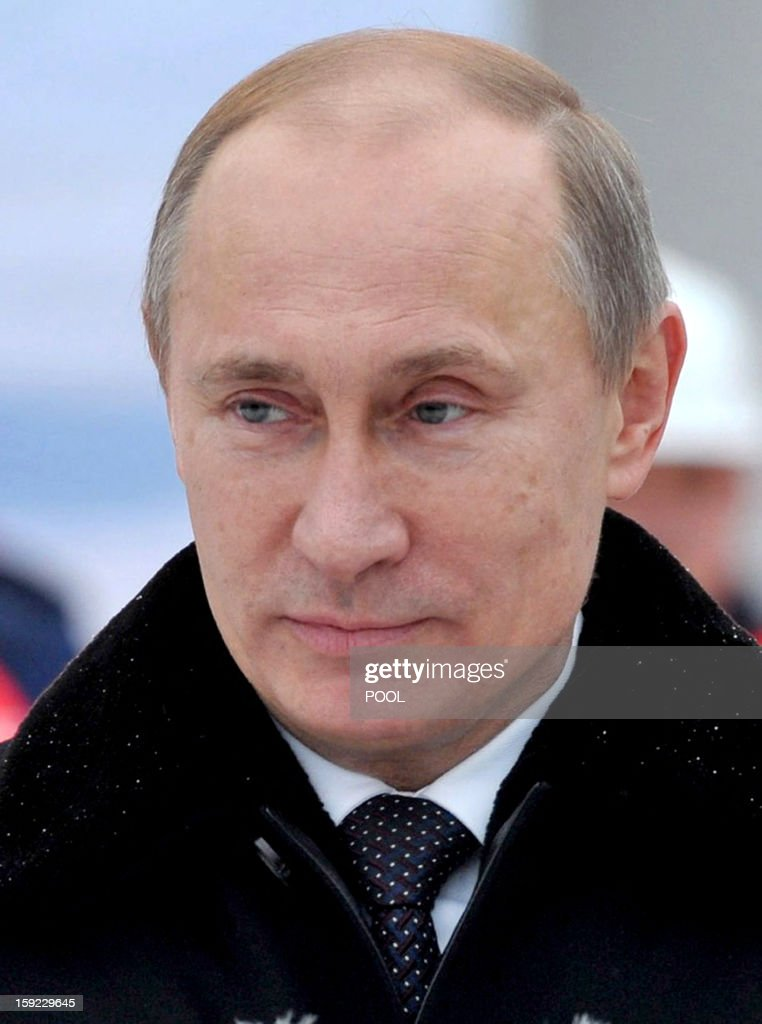 Russia's President Vladimir Putin visits the Vitus Bering nuclear-powered icebreaker in the Russian northwest city of St. Petersburg, on January 10, 2013. A 14-year-old Russian orphan with a debilitating genetic disease has reportedly asked Putin for the right to live with his prospective adoptive family in the United States.
