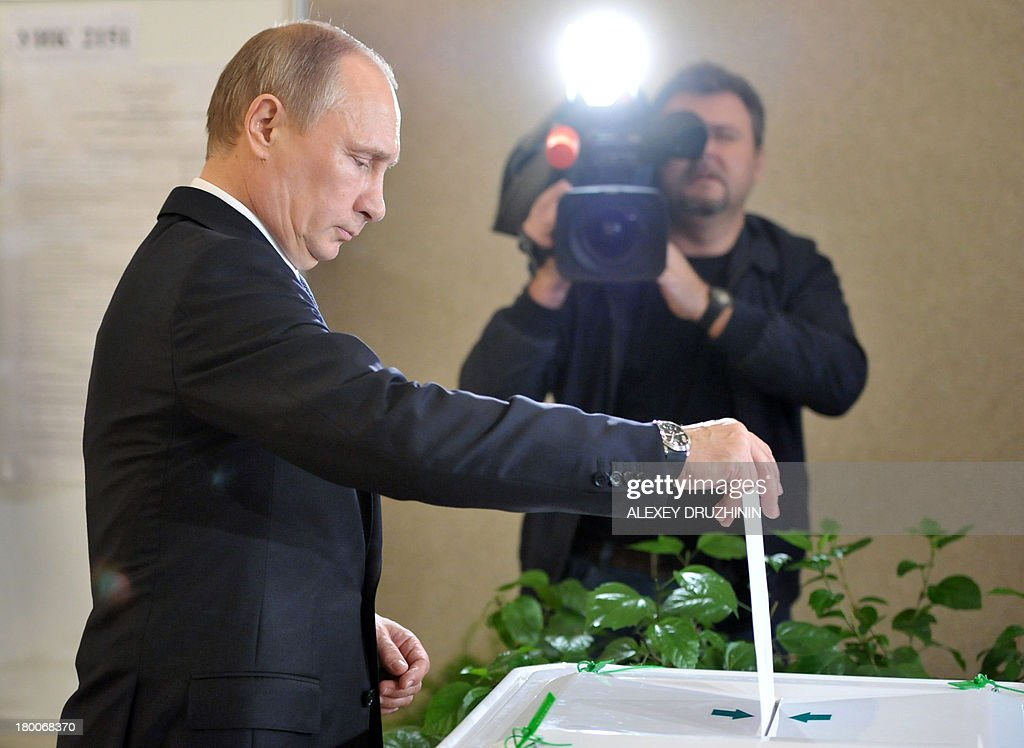 Russia's President Vladimir Putin votes at a polling station during a mayoral election in Moscow, on September 8, 2013. Putin's top critic, Alexei Navalny, faced today a Kremlin-backed Sergei Sobyanin in a hotly contested Moscow mayoral poll, the first time an opposition leader has been allowed to stand in a high-profile election. AFP PHOTO / RIA-NOVOSTI / POOL / ALEXEY DRUZHININ