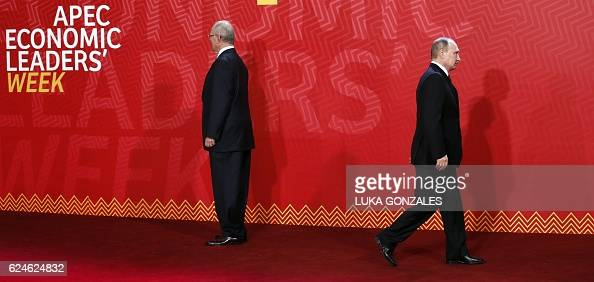 TOPSHOT Russia's President Vladimir Putin walks as he arrives at the Lima Convention Centre for the APEC Leaders' Retreat on the last day of the...