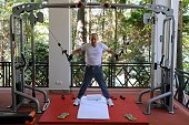 Russias President Vladimir Putin works out at a gym at the Bocharov Ruchei state residence in Sochi on August 30 2015 AFP PHOTO / RIA NOVOSTI /...