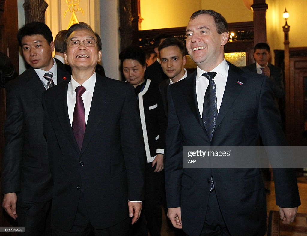 Russia's Prime Minister Dmitry Medvedev (R) and China's Prime Minister Wen Jiabao arrive for a joint press conference after their meeting in Moscow, on December 6, 2012. Wen Jiabao is on a visit to Russia.