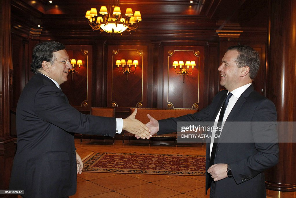 Russia's Prime Minister Dmitry Medvedev (R) and EU commission President Jose Manuel Barroso shake hands during their meeting in the Gorki residence outside Moscow, on March 21, 2013. Medvedev slammed today current European proposals to solve the Cyprus crisis as absurd, while Cypriot Finance Minister Michalis Sarris was set to hold further talks in Moscow over aid.