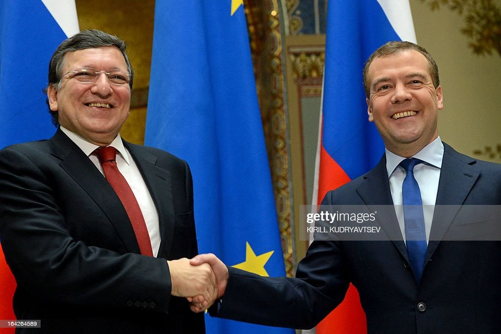 Russia's Prime Minister Dmitry Medvedev (R) and EU commission President Jose Manuel Barroso shake hands as they meet in Moscow, on March 22, 2013. Barroso is in Russia on the second day of his talks that touch on the Cyprus banking crisis. AFP PHOTO / KIRILL KUDRYAVTSEV
