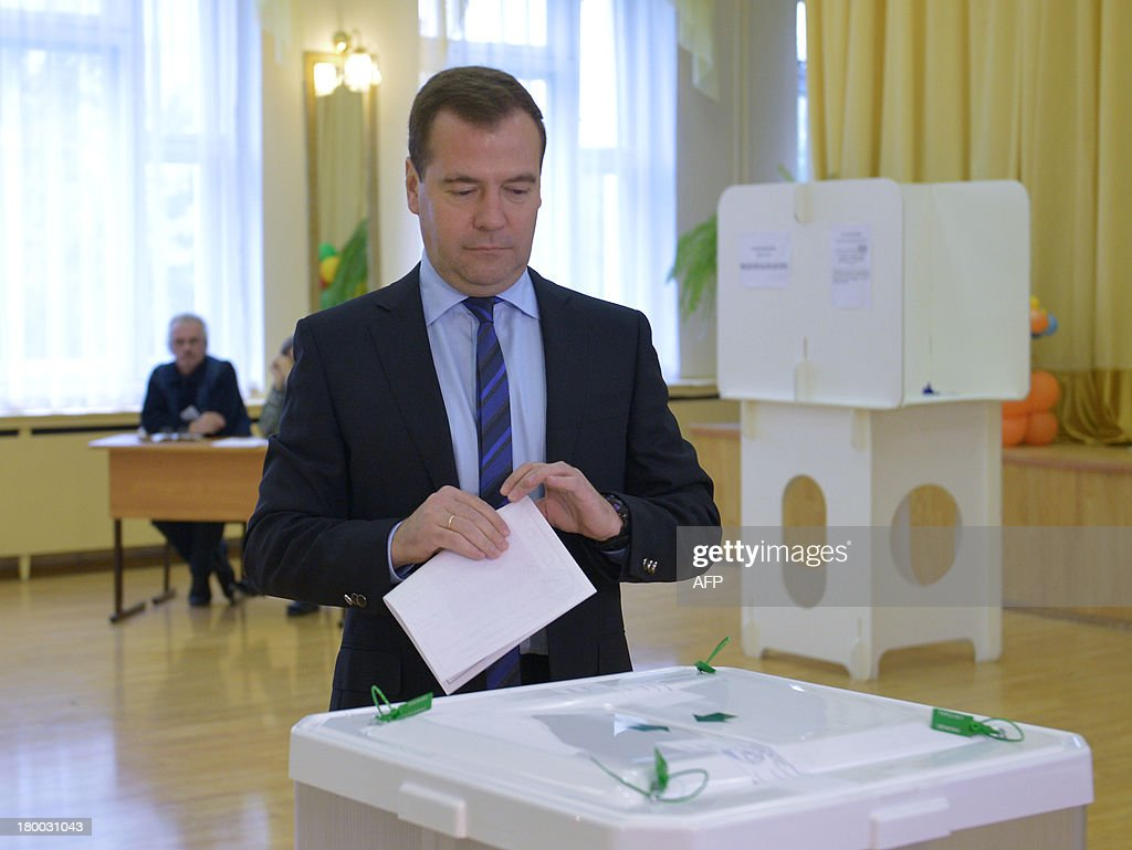 Russia's Prime Minister Dmitry Medvedev casts his ballot at a polling station during a mayoral election in Moscow, on September 8, 2013. Top critic of President Vladimir Putin, Alexei Navalny, faced today a Kremlin-backed Sergei Sobyanin in a hotly contested Moscow mayoral poll, the first time an opposition leader has been allowed to stand in a high-profile election.