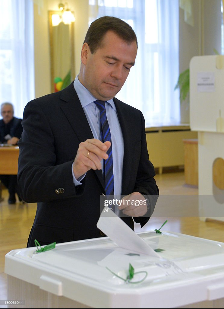 Russia's Prime Minister Dmitry Medvedev casts his ballot at a polling station during a mayoral election in Moscow, on September 8, 2013. Top critic of President Vladimir Putin, Alexei Navalny, faced today a Kremlin-backed Sergei Sobyanin in a hotly contested Moscow mayoral poll, the first time an opposition leader has been allowed to stand in a high-profile election. AFP PHOTO / RIA-NOVOSTI / POOL / ALEXANDER ASTAFYEV