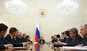 Russias Prime Minister Dmitry Medvedev chairs a meeting with representatives of the government finance and economy units Central Bank management...