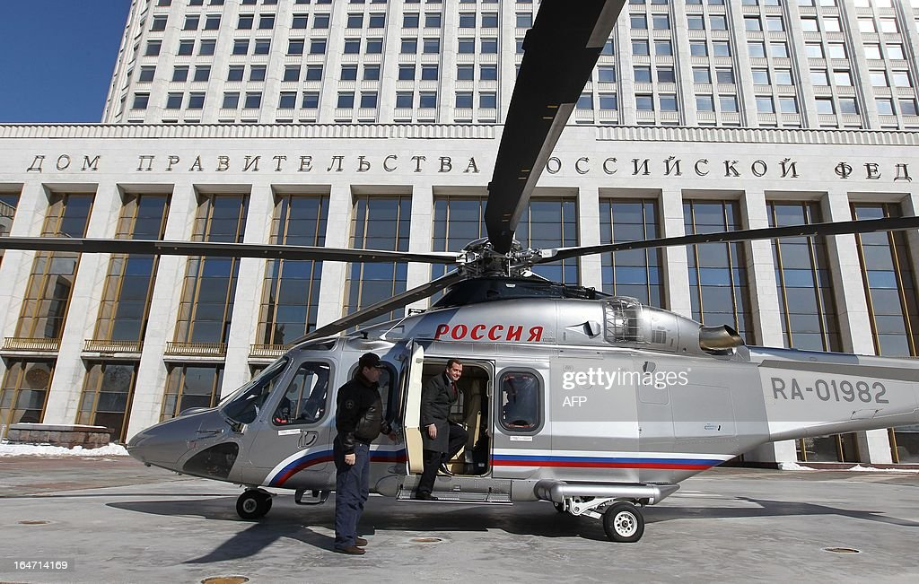 Russia's Prime Minister Dmitry Medvedev gets out from a helicopter at a pad just outside the government headquarters in Moscow, on March 27, 2013.