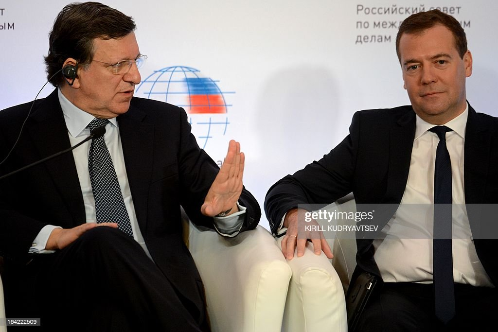 Russia's Prime Minister Dmitry Medvedev (R) listens to EU commission President Jose Manuel Barroso as they meet in Moscow, on March 21, 2013. Medvedev slammed today current European proposals to solve the Cyprus crisis as absurd, while Cypriot Finance Minister Michalis Sarris was set to hold further talks in Moscow over aid.