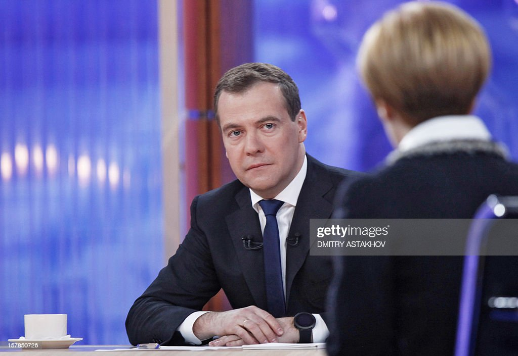Russia's Prime Minister Dmitry Medvedev looks on during his interview with five major national television channels in Moscow, on December 7, 2012.