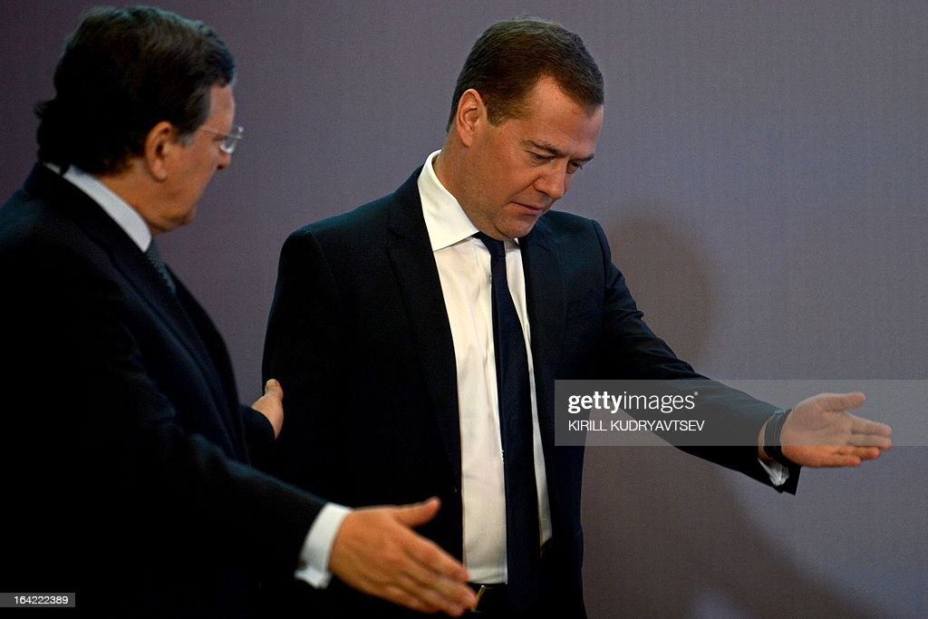 Russia's Prime Minister Dmitry Medvedev (R) meets EU commission President Jose Manuel Barroso in Moscow, on March 21, 2013. Medvedev slammed today current European proposals to solve the Cyprus crisis as absurd, while Cypriot Finance Minister Michalis Sarris was set to hold further talks in Moscow over aid.