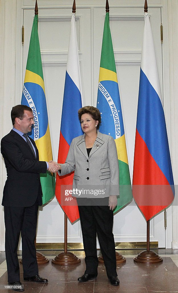 Russia's Prime Minister Dmitry Medvedev (L) shakes hands with Brazil's president Dilma Rousseff during their meeting in Moscow, on December 13, 2012. Rousseff is on a visit to Russia.