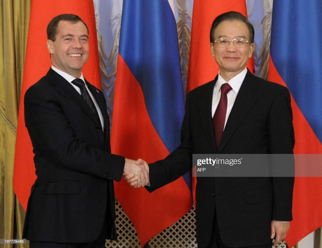 Russia's Prime Minister Dmitry Medvedev (L) shakes hands with China's Prime Minister Wen Jiabao during their meeting in Moscow, on December 6, 2012. Wen Jiabao is on a visit to Russia. AFP PHOTO/ RIA-NOVOSTI/ POOL/ YEKATERINA SHTUKINA