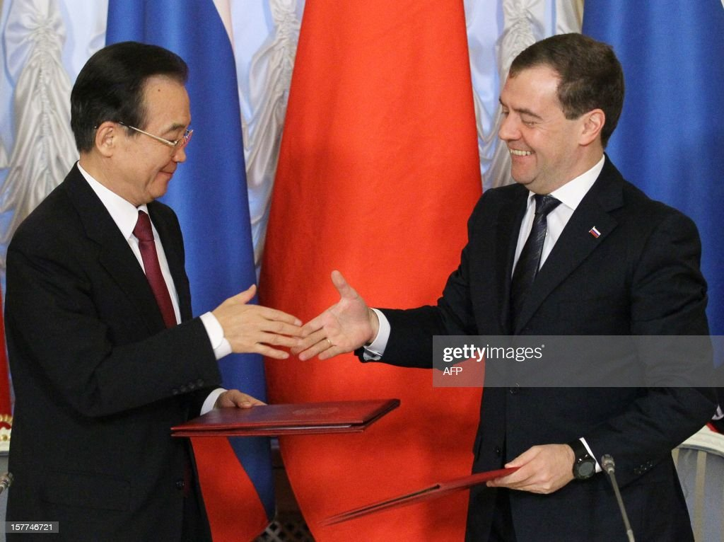 Russia's Prime Minister Dmitry Medvedev (R) shakes hands with China's Prime Minister Wen Jiabao during their meeting in Moscow, on December 6, 2012. Wen Jiabao is on a visit to Russia.