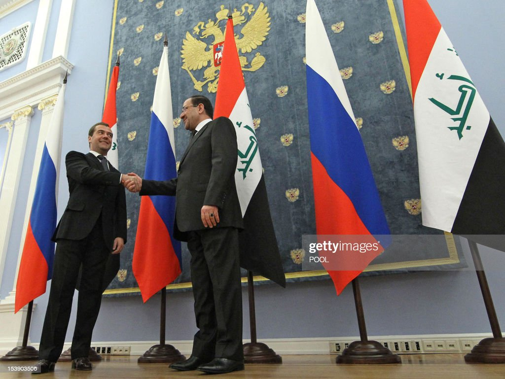 Russia's Prime Minister Dmitry Medvedev (L) shakes with his Iraq's counterpart Nouri Al-Maliki during meeting in the Gorki residence outside Moscow, on October 9, 2012. Russia unveiled this week $4.2 billion in arms deals with Iraq that make it the strife-torn nation's largest weapons supplier after the United States and firm up its slipping foothold in the Middle East.