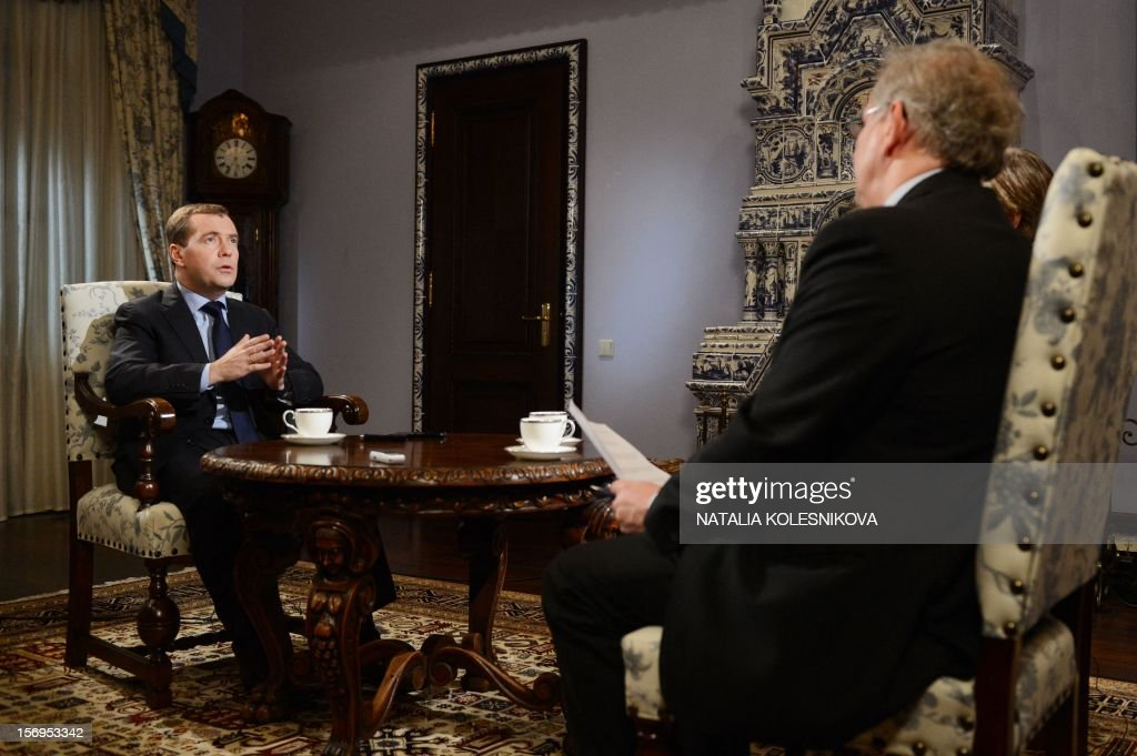 Russia's Prime Minister Dmitry Medvedev (L) speaks during an interview with Agence France Presse and French daily Le Figaro in the Gorki residence outside Moscow, on November 23, 2012. AFP PHOTO / NATALIA KOLESNIKOVA NOVEMBER 26, 2012 at 0500 GMT - THIS