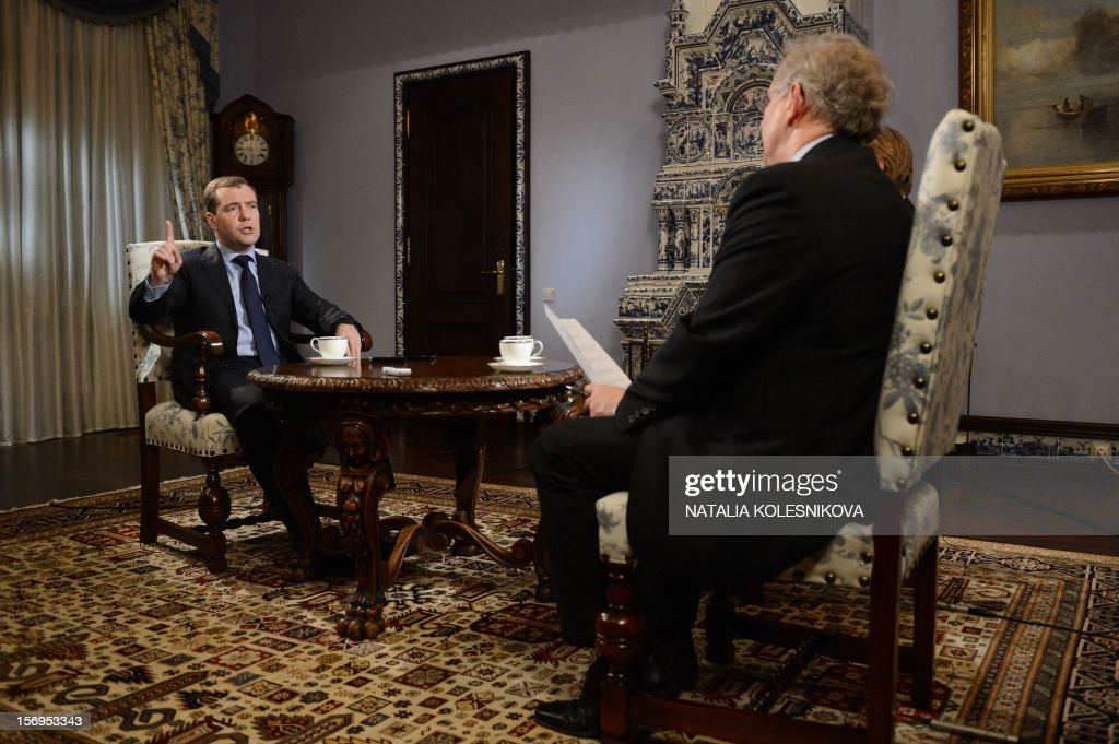 Russia's Prime Minister Dmitry Medvedev (L) speaks during an interview with Agence France Presse and French daily Le Figaro in the Gorki residence outside Moscow, on November 23, 2012. AFP PHOTO / NATALIA KOLESNIKOVA NOVEMBER 26, 2012 at 0500 GMT - THIS RESTRICTION APPLIES TO ALL MEDIA INCLUDING WEBSITES
