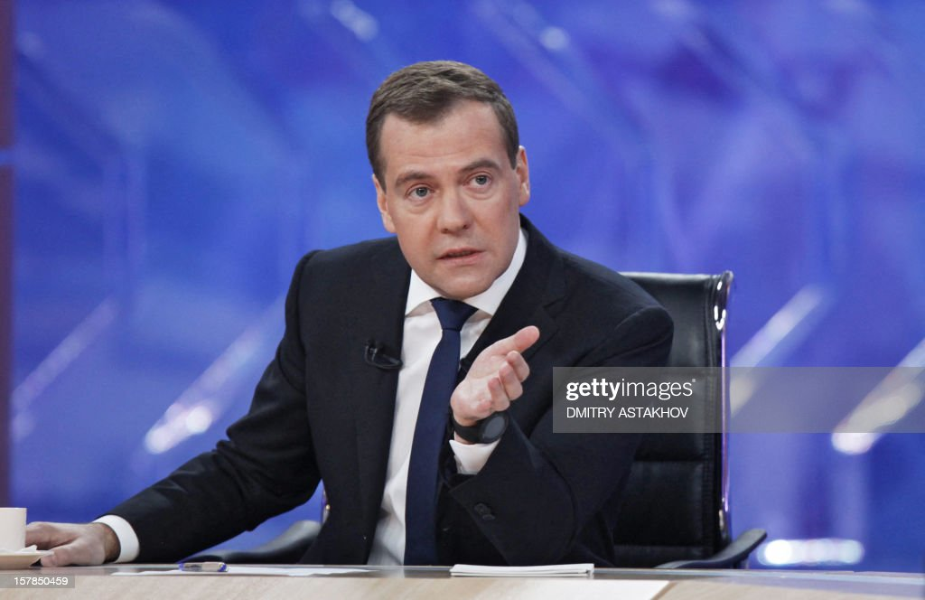 Russia's Prime Minister Dmitry Medvedev speaks during his interview with five major national television channels in Moscow, on December 7, 2012 .