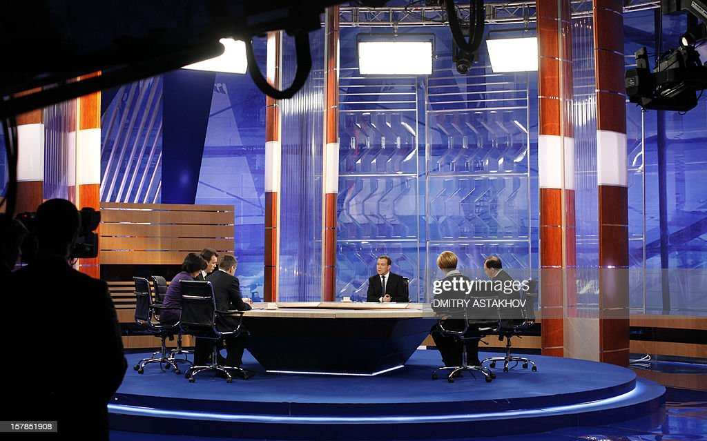 Russia's Prime Minister Dmitry Medvedev (3rd R) speaks during his interview with five major national television channels in Moscow, on December 7, 2012.