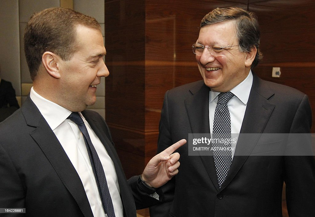 Russia's Prime Minister Dmitry Medvedev (L) speaks with EU commission President Jose Manuel Barroso as they meet in Moscow, on March 21, 2013. Medvedev slammed today current European proposals to solve the Cyprus crisis as absurd, while Cypriot Finance Minister Michalis Sarris was set to hold further talks in Moscow over aid. AFP PHOTO/ RIA-NOVOSTI POOL / DMITRY ASTAKHOV