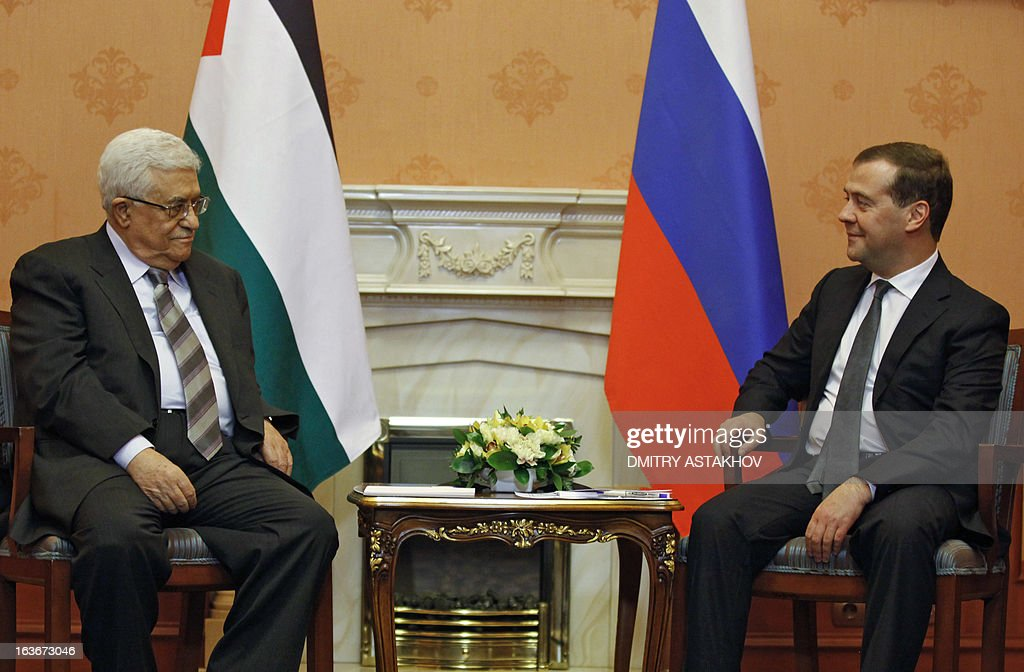 Russia's Prime Minister Dmitry Medvedev (R) speaks with Palestinian President Mahmoud Abbas as they meet in Moscow, on March 14, 2013.