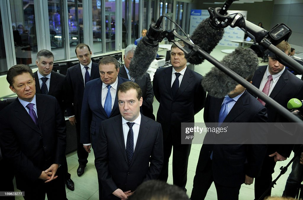 Russia's Prime Minister Dmitry Medvedev (C) visits the recently built Adler thermal power plant in the Russian Black Sea resort of Sochi, on January 21, 2013, with Russian gas giant Gazprom CEO, Alexei Miller (L), attending. The 360 MW Adler thermal power plant will be one of the main sources of power for the coastal cluster of the Sochi 2014 Olympic venues.