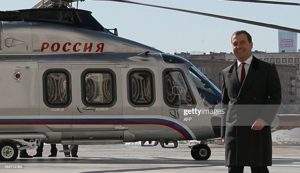 Russia's Prime Minister Dmitry Medvedev walks away from a helicopter at a pad just outside the government headquarters in Moscow, on March 27, 2013.