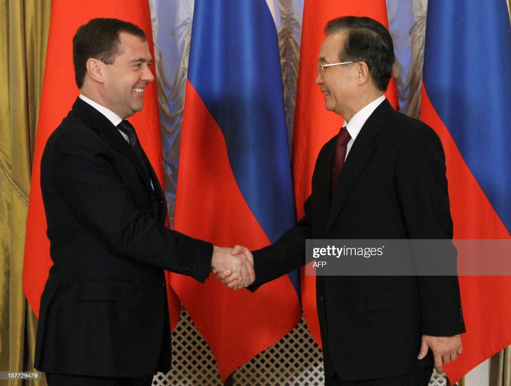 Russia's Prime Minister Dmitry Medvedev (L) welcomes China's Prime Minister Wen Jiabao during their meeting in Moscow, on December 6, 2012. Wen Jiabao is on a visit to Russia.