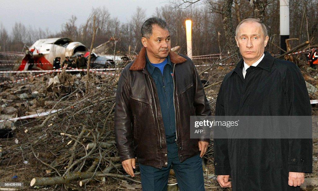Russia's Prime Minister Vladimir Putin and Emergencies Minister Sergei Shoigu visit the site of a Polish government Tupolev Tu154 aircraft crash near...