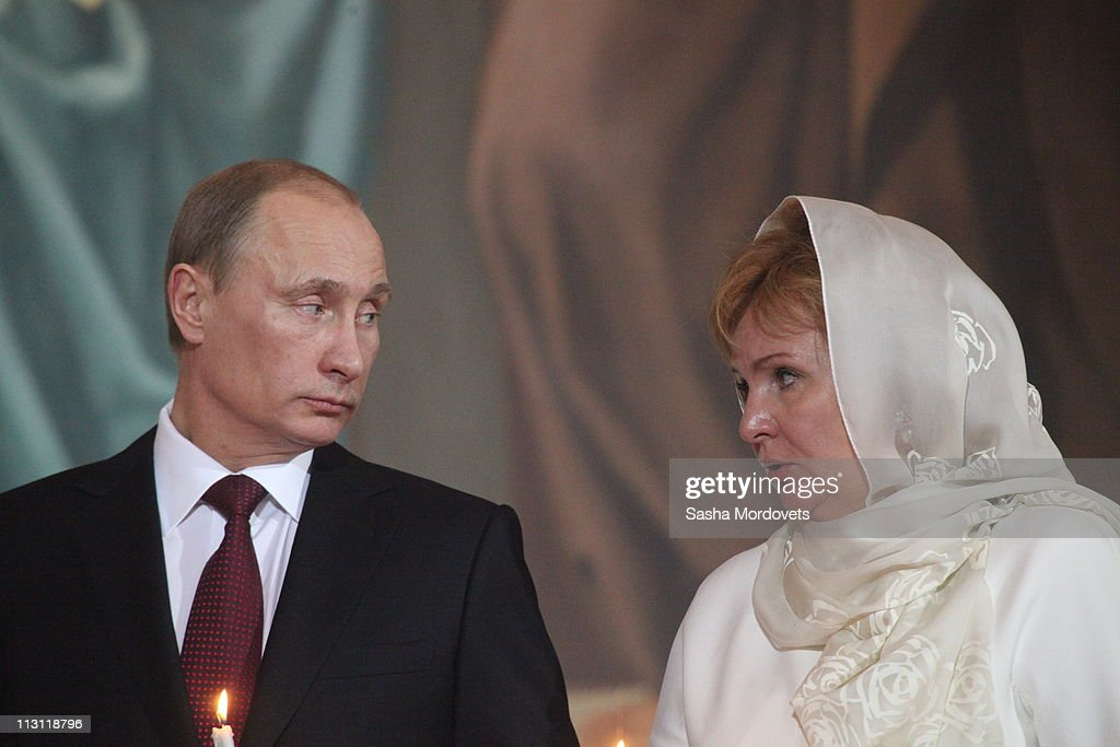 Russia's Prime Minister <a gi-track='captionPersonalityLinkClicked' href=/galleries/search?phrase=Vladimir+Putin&family=editorial&specificpeople=154896 ng-click='$event.stopPropagation()'>Vladimir Putin</a> (L) and his wife Lyudmila Putina (R) pray during an Orthodox Easter service in the Christ the Saviour Cathedral on April 24, 2011 in Moscow. Russia. This year, Orthodox and Catholic churches are celebrating Easter on the same date.