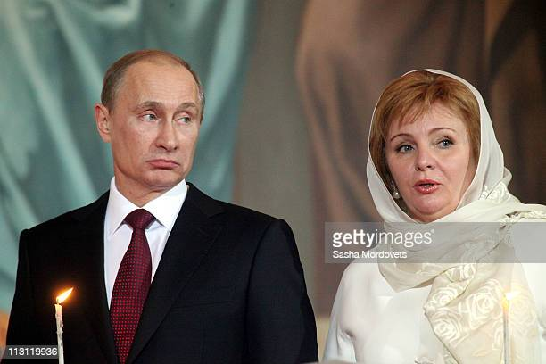 Russia's Prime Minister Vladimir Putin and his wife Lyudmila Putina pray during an Orthodox Easter service in the Christ the Saviour Cathedral on...