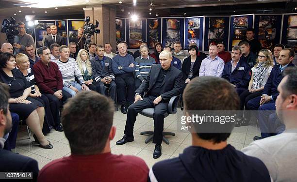 Russia's Prime Minister Vladimir Putin meets with Russia's mining giant Norilsk Nickel workers and employees in the Arctic city of Norilsk on August...