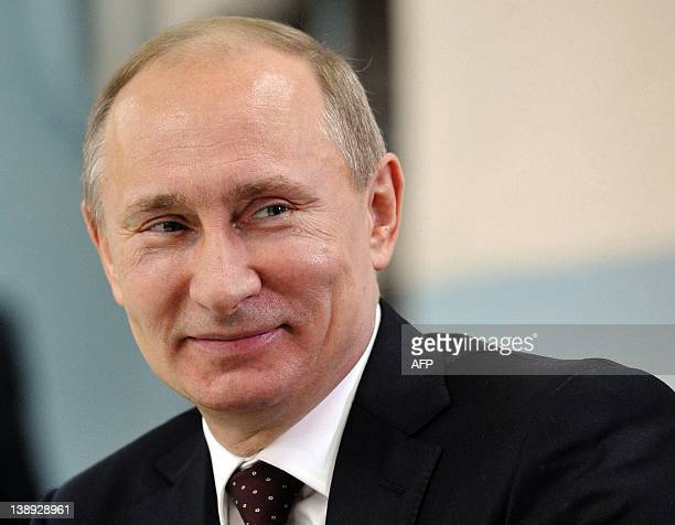 Russia's Prime Minister Vladimir Putin smiles as he visits a high school in the Urals city of Kurgan on February 13 2012 After serving two...