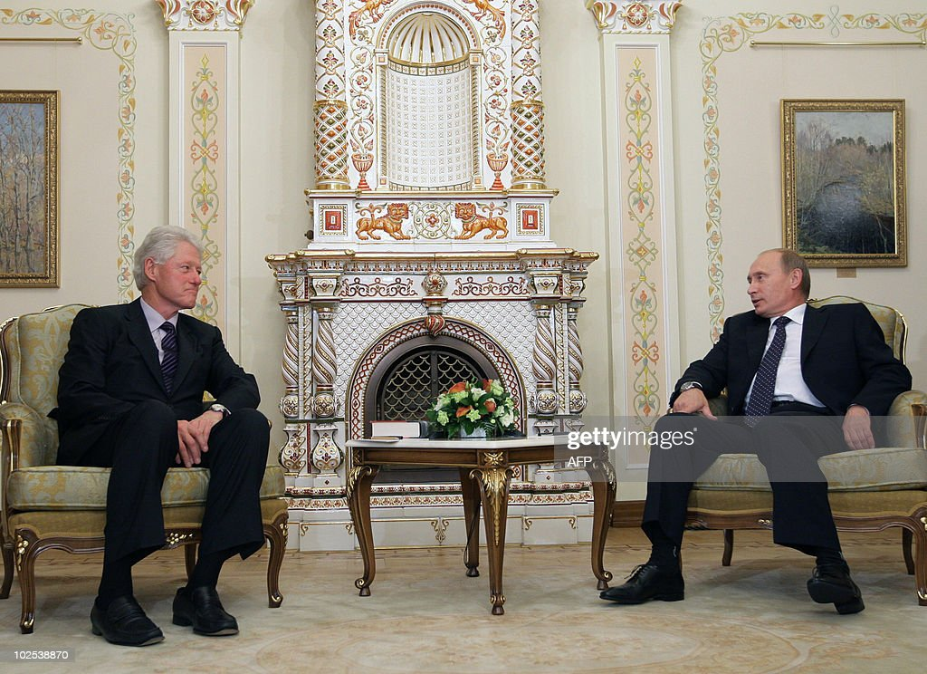 Russia's Prime Minister Vladimir Putin (R) speaks with former US President Bill Clinton at the State residence of the Russian President Novo-Ogaryovo outside Moscow on June 29, 2010. Russia bristled at US claims that it had smashed a Cold War-style Russian spy ring as former KGB spy and Prime Minister of Russia Vladimir Putin expressed hope the scandal would not damage improving bilateral relations.