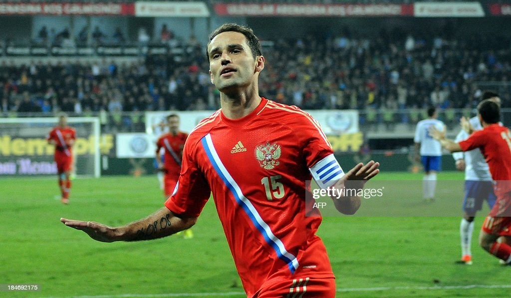 Russia's Roman Shirokov celebrates after scoring during the FIFA World Cup 2014 qualifying football match Azerbaijan vs Russia in Baku on October 15, 2013.