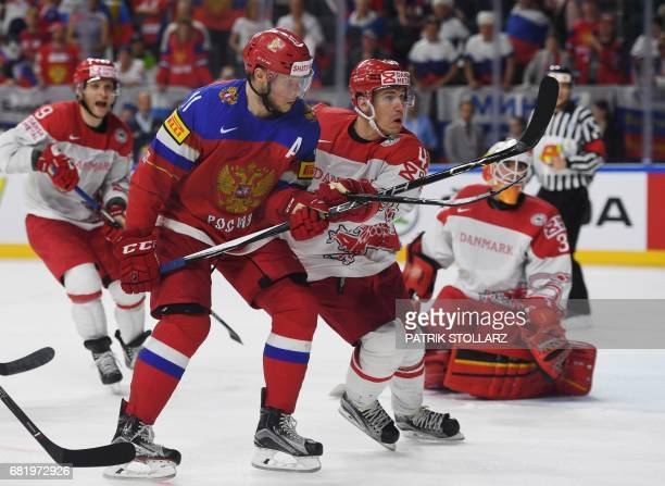 Russia's Sergei Andronov and Denmark's Mikkel Aagaard vie during the IIHF Ice Hockey World Championships first round match between Russia and Denmark...