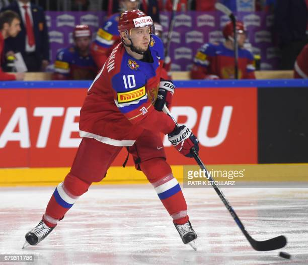 Russia´s Sergei Mozyakin vies for the puck during IIHF Ice hockey world championship first round match between Sweden and Russia in the LANXESS arena...