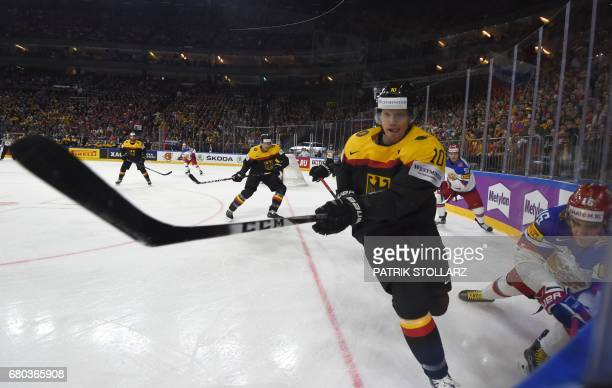CORRECTION Russia's Sergei Plotnikov and Germany's Christian Ehrhoff vie for the puck during the IIHF Ice Hockey World Championship first round match...