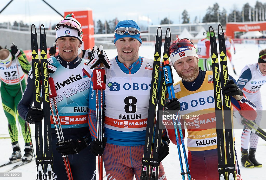Russia's Sergej Ustiugov (C) celebrates winning the men's 15km competition with 2nd placed Francesco De Fabiani (L) from Italy and 3rd placed Martin Johnsrud Sundby from Norway at the FIS Cross-Country World Cup in Falun, Sweden, on February 14, 2016. / AFP / TT News Agency / Maja Suslin/TT / Sweden OUT