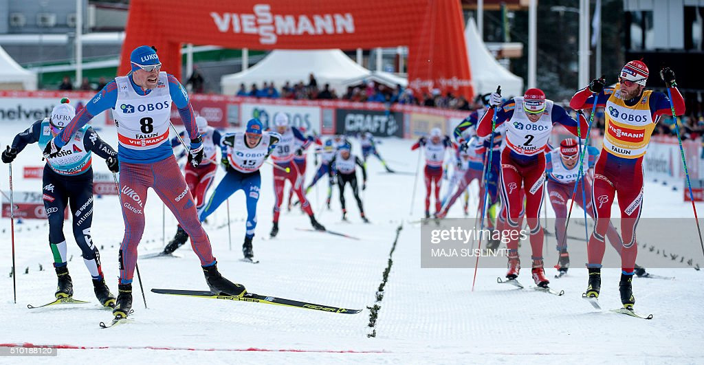 Russia's Sergey Ustiugov (L, no 8) crosses the finish line to win the men's 15 km freestyle competition at the FIS Cross-Country World Cup in Falun, Sweden, February 14, 2016. / AFP / TT News Agency / Maja Suslin/TT / Sweden OUT