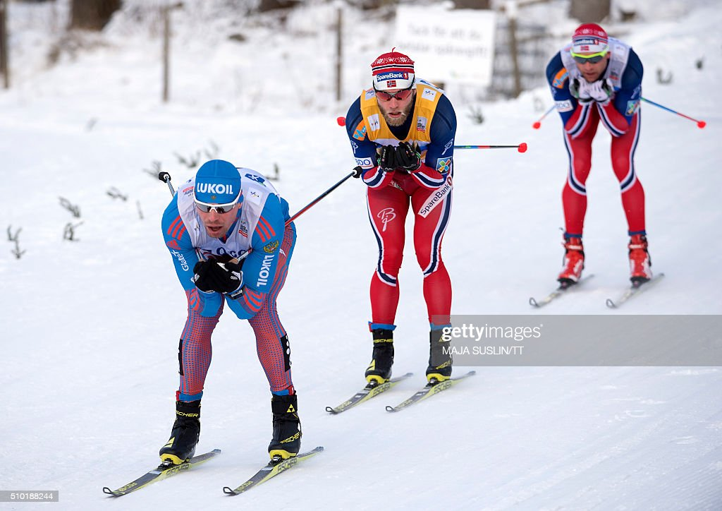 Russia's Sergey Ustiugov, Norway's Martin Johnsrud Sundby and Petter Northug of Norway compete in the men's 15 km freestyle competition at the FIS Cross-Country World Cup in Falun, Sweden, February 14, 2016. / AFP / TT News Agency / Maja Suslin/TT / Sweden OUT