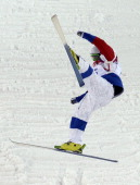 Russia's Sergey Volkov falls in the Men's Freestyle Skiing Moguls qualifications at the Rosa Khutor Extreme Park during the Sochi Winter Olympics on...