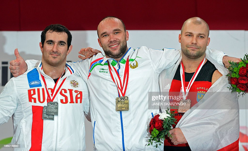 Russia's silver medalist David Bedzhanyan, gold medalist Ruslan Nurudinov of Uzbekistan, and Poland's bronze medalist Bartlomiej Bonk pose on the podium after winning in the men's 105 kg weightlifting IWF World Championships at Centennial Hall in Wroclaw, Poland on October 27, 2013.