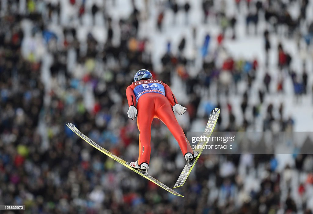 Russia's ski jumper Dimitry Vassiliev soars through the air during his qualification jump at the 61th edition of the Four-Hills-Tournament (Vierschanzentournee) on December 31, 2012 in Garmisch-Partenkirchen, southern Germany. The second competition of the jumping event will take place in Garmisch-Partenkirchen, before the tournament continues in Innsbruck (Austria) and in Bischofshofen (Austria).