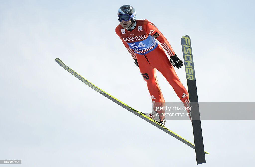 Russia's ski jumper Dimitry Vassiliev soars through the air during his trial jump at the 61th edition of the Four-Hills-Tournament (Vierschanzentournee) on December 31, 2012 in Garmisch-Partenkirchen, southern Germany. The second competition of the jumping event will take place in Garmisch-Partenkirchen, before the tournament continues in Innsbruck (Austria) and in Bischofshofen (Austria).